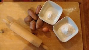 lasagne di Patate al ragù di polpo, pesto di zucchine e pomodori confit